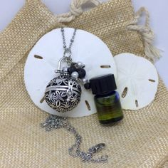 Aromatherapy Lava Cage Pendant Necklace #essential…Edit description Essential Oil Diffuser, Essential Oil Blends, Essential Oils, Burlap Gift Bags, Frugal Family, Small Bottles, Garden Tips, Stainless Steel Chain, Natural Living