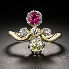 French Antique Ruby and Yellow Diamond Ring, A bright vibrant red natural Burma ruby shares equal billing with a sunshiny old mine-cut diamond in this ultra-sweet and lovely sparkler from nineteenth century France. The radiant pair are set in platinum buttercup settings on either side of a trio of round European-cut diamond sparklers.