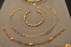 Seven Necklaces Roman, 175-225 C.E. Gold, Glass, Amethyst, Pearl, and Emerald. Cabinet des Medailles, Paris, VEX.2014.134, 138-143