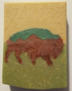 """There are many buffalo in Yellowstone. This one has the mountains in the design (similar to the Tetons). I wanted a more """"rough"""" look to him, and I believed I achieved that. Phoenix Homes, Soaps, Buffalo, Mountains, Design, Hand Soaps, Water Buffalo, Soap, Bergen"""