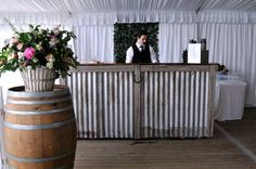 RUSTIC BUSH BAR. Made from corrugated iron, recycled timbers and horseshoe adornment, our rustic Bush Bar is perfect for any country styled event. Hire Bush Bar: Your Event Solution | YES #weddings #WeddingHire #YourEventSolution