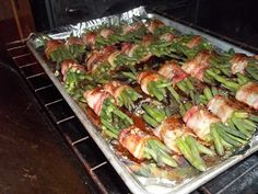 Green Beans Wrapped in Bacon (with brown sugar and soy sauce). You can do these with fresh green beans.  You can also use frozen.  They will do just wonderfully and they are easier to stack up and roll.