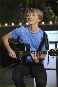 Sterling Knight serenades Danielle Campbell in this brand-new still from their upcoming DCOM, StarStruck. Description from justjaredjr.com. I searched for this on bing.com/images