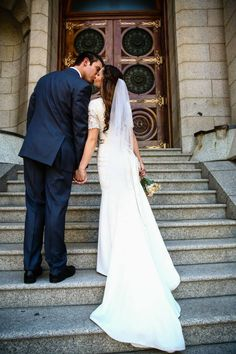 modest wedding dress with lace sleeve and a slim fit from alta moda.  --(modest bridal gown)--