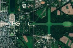 Amazing Satellite Photo Gallery of Famous Landmarks on Earth - Thrillist Versailles Garden, Ferrari World, Earth From Space, Famous Landmarks, Angkor Wat, Aerial View, City Photo, Photo Galleries, Places To Visit
