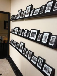 Genealogy photo wall.  Photos are marked with our ancestor's name, birth and death dates, and relationship to either me or my husband.  Photos displayed for 6 generations on both our lines.