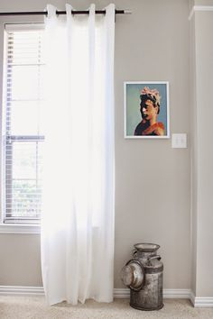 Displaying heirlooms and family art, Behr Sculptors Clay, grey beige wall color, antique vintage milk pan, Mid Mod Inspirations