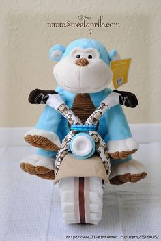 Sweetaprils: Motorcycle Diaper Cake Tutorial {DIY-How to Make a Diaper Motorcycle}<< OMGEE! Making this for the next baby shower I host instead of a diaper cake! Baby Shower Gifts For Boys, Baby Shower Parties, Baby Boy Shower, Baby Showers, Shower Party, Man Shower, Shower Favors, Diaper Bike, Diaper Motorcycle Cake