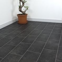 Our Inspiration Cheyenne Cushioned Vinyl Flooring has a gorgeous black tile effect, perfect for ultra modern kitchens and bathrooms. This floor is embossed with a realistic tyle effect but is highly durable and water resistant.