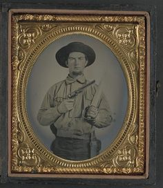 Soldier in Confederate uniform with Colt Navy revolver and double handle D-guard Bowie knife