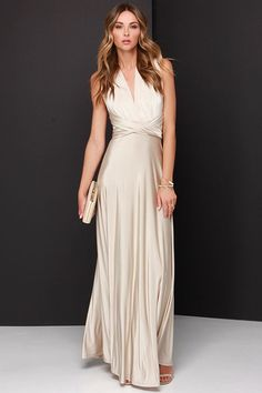 """Any which way you wrap it, the Always Stunning Convertible Beige Maxi Dress is one amazing dress! Two, 83"""" long lengths of fabric sprout from an elastic waistband and wrap into dozens of possible bodice styles including halter, one-shoulder, cross-front, strapless, and more. Stretchy beige fabric has a satiny sheen, and a full length maxi skirt pairs perfectly with any choice you make up top. Want Styling Tips? <a href='http://bit.ly/HowToWearIt' target='_blank'>See How To Wear It!</a>"""