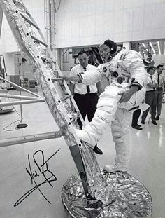 Neil Armstrong practices reaching the first rung of the ladder to climb back into the Lunar Module Eagle in this image from July one week before Apollo 11 launched.