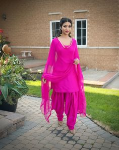 Hot pink plain Punjabi salvar suit in silk, lace work in dupatta.