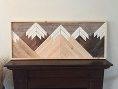 Calling all wilderness lovers! This is a hand cut, hand stained, and hand sealed with love piece of art. Made to look like the mountains, it will surely appeal