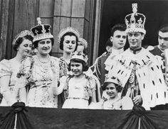 Princess Elizabeth shown here (fourth from left), age 11, on the balcony of Buckingham Palace, after her father George VI's coronation. The death of Elizabeth's beloved father in 1952 propelled her onto the throne at age 25.