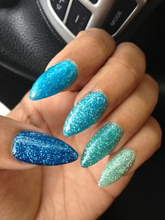different shades of blue glitter...Stiletto nails. Sharp!!