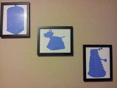 Doctor Who characters cut out on construction paper and put into frames.