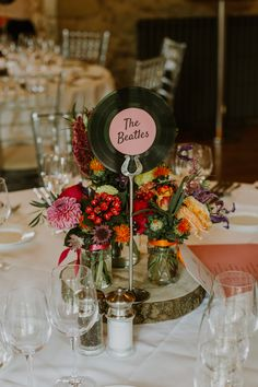 wedding table decorations 374361787776299334 - Music Records Vinyl Table Name Centrepiece Log Table Decor Flowers Notley Abbey Wedding Alexandra Jane Photography # Source by marion_gaupp Retro Wedding Theme, Wedding Table Themes, Wedding Music, Wedding Table Numbers, Our Wedding, Wedding Dress, Rockabilly Wedding Decorations, Wedding Flowers, Wedding Reception