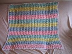 The Shells and Stripes Baby Afghan is simple and sweet. These shell afghan instructions will show you how to make striped shell stitch afghans for baby in any colors that match the nursery or gender of the baby. It also has cute picot edging! Crochet Ripple, Baby Afghan Crochet, Baby Afghans, Afghan Crochet Patterns, Free Crochet, Crochet Blankets, Baby Blankets, Knitting Patterns, Ripple Afghan