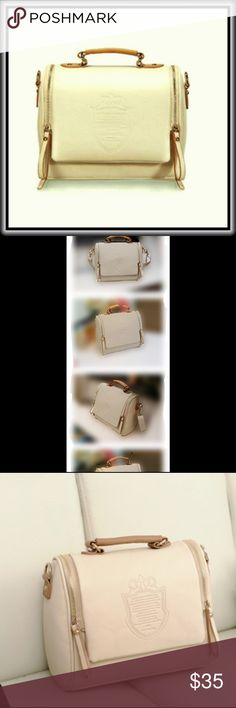 """CROSSBODY SATCHEL HANDBAG Comfortably sized, this Cream color satchel bag can be worn with jeans and a T-Shirt, or your evening 'let's go out' outfit.  It is a nice faux-leather with two zippers that open the top for maximum exposure. The back sports a zippered pocket for quick access access to your phone. Inside has two open  pockets and one zippered.                             I use one of the purse insert in mine.  It fits perfectly and definitely reduces any """"digging"""" time. Bags…"""