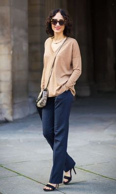 Toss on a drapey sweater with polished trousers and stilettos.... - Street Style