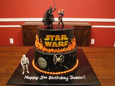"""""""Star Wars cake - Trying out an airbrush for the first time- colored chocolate buttercream black... fun but boy did I learn a lot.  All buttercream with fondant letters (airbrushed) and death star.  Tie fighter is a FBCT."""""""