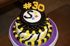 30th Birthday cake for a former Steelers cheer leader who is a great RN for kids! This was fun to make. Red Velvet cake with a cream cheese frosting.