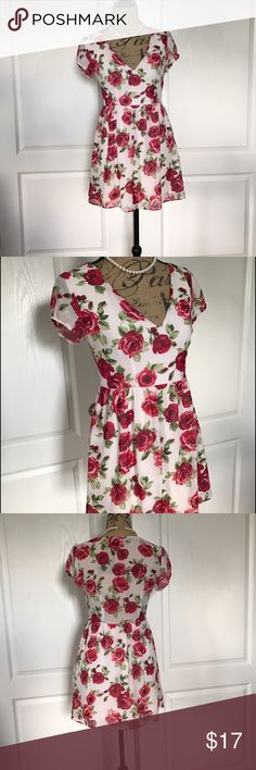 Legend Mini Floral dress Fun, flirty, mini day dress. Comes from a smoke free home. ‼️Get a free item with purchase. Check out my Free item listings and let me know what you'd like to pair this with and I'll create a new listing for you with your free item! Happy Poshing! ❤️☮️ Dresses Mini