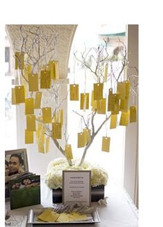 Instead of a guestbook use a wishing tree. Set tree branches in a flowerpot or glass vase; adorn it with white lights, paper flowers or crystals. Print wish tags with your names and date on them and let your guests write well wishes and hang them with ribbon from tree.