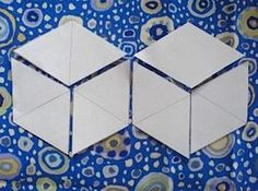If you want to make a tumbling blocks quilt using the English Paper Piecing method this tutorial will show you how to make to the paper diamonds you'll need. All you need to get started is paper, a pencil, a ruler and a compass!