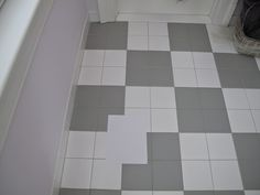 Gray and white checkered tile in bathroom