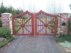 Custom wooden gate made to look like wagon wheels. Click to see more wood gates #entrance #gates #wood #home