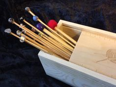 Here we have featured our exclusive wooden storage boxes. They make a fabulous focal point for any craft area and can hold around 40 pairs of needles (even with some of our massive beads on the ends).  Why buy these? Its been proven that storing bamboo needles in a wooden box helps to keep them in great condition, stops them getting bowed and generally helps to look after them, be kind to your needles! The box measurements are 33.5cm x 9cm x 9cm the lid slides off and allows you to use it as…