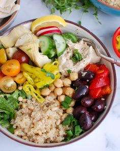 This Greek Quinoa Bowl Recipe is a healthy mix of your favorite Greek ingredients topped over gluten-free quinoa. You can mix things up but I like adding hummus, vegetables, greens, olives, feta cheese and artichokes to myquinoa bowl.// acedarspoon.com #quinoa #mediterraneandiet #vegetables #vegetarian