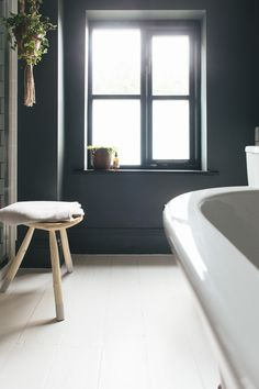 dark bathroom with natural neutral colour accents