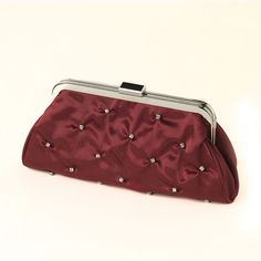 This fabulous rhinestone embellished red satin evening bag with silver  plating is absolutely stunning.  Clasp opens to side pocket inside with  chain that can be added on or used without.  This is perfect to add a  touch of glamour to your evening night outSize: 9 Length  5 Height 1 Width
