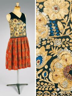 Paul Poiret | top: black satin + embroidery + sequins + metal + rhinestones | skirt: red silk brocade | Paris, France | c. 1920