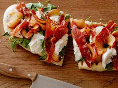Grilled Summer Pizzette with Caramelized Peaches, Burrata, Arugula and Crispy Serrano recipe  via Food Network