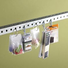 Use a metal rod (hardware store) and binder rings to hang scrapbooking supplies in plastic bags