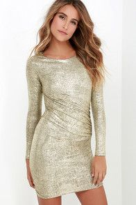 Cameras will flash when you don the Diamond Heart Gold Bodycon Dress! Shiny, textured gold fabric shapes a mock neck and sleeveless, princess seamed bodice. Sexy bodycon silhouette. Hidden back zipper.