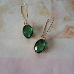 "☆HOST PICK☆ Green stone earrings Host pick 2/25. Gold tone metal. Faceted green stone.  2"" long.  No trades or PP.  Save even more with a bundle discount! Jewelry Earrings"
