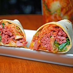Corned Beef and Kimchi Burritos |   ½ lb corned beef (leftover or deli meat both work)  ½ cup kimchi  ¼ cup sauteed cabbage  ¼ cup onion and cilantro relish*  ¼ cup salsa verde*  ½ cup cheddar cheese, shredded  2 burrito-sized tortillas