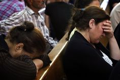 Iraqi Christians who fled the violence in the village of Qara Qosh in northern Iraq rest and pray at St. Joseph Church in the Kurdish city of Erbil on Thursday.