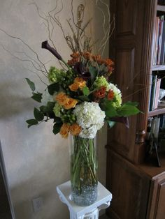 Tall centerpiece design with hydrangea, calla, spray rose, hypericum, curly willow and fall mums. www.facebook.com/fancyfloralsbynancy