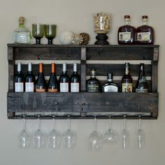 Exclusive pallet wine rack for sale on VinoGrotto. Has a beautiful dark espresso finish. Stores 12 bottles and 8 glasses. 90 day money-back guarantee.  Need this!