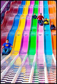 Photo by !royale!: http://www.flickr.com/photos/narnonic/1148027013/    Amusement park slide with multiple parallel slideways. I enjoyed going on these when I was younger while visiting fairs and local carnivals.    I'd be playing on this thing for hours on end if I had one in a backyard.