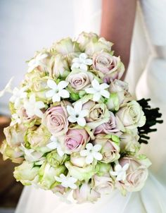 The star-shaped stephanotis adds a fun touch to any bouquet. Type of flowers: Pale pink and ivory roses, dahlias, stephanotis. Floral Bouquets, Wedding Bouquets, Wedding Flowers, Floral Wedding, Wedding Dresses, Ivory Roses, Blush Roses, Reception Decorations, Flower Decorations
