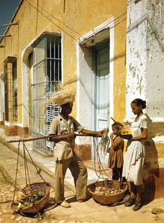 Street vendor and patrons, Havana, Cuba, ca. 1950