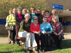 The Meeker Grandmas, a group of retired Meeker staff, started meeting 26 years ago as a way to socialize and share photos and stories of their grandchildren. The group gathered at Meeker on Wednesday to say goodbye to the building, which will be demolished this summer before the new Meeker school opens in the fall. They are pictured here around a memorial bench they helped build for June Gibson, a grandma who died in 1994. Photo by Melissa Erickson/Ames Tribune