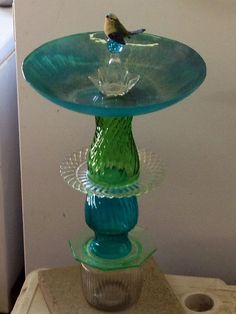 Recycled+glass+birdbath. Sheila made this out of vases and plates, & used GE Silvone II to hold it together. Difficulty: Easy